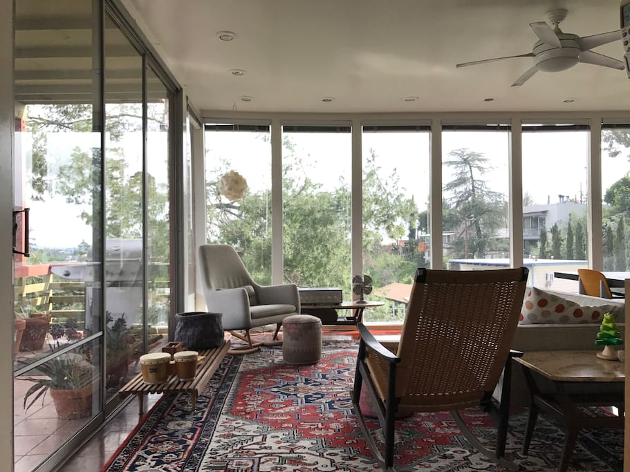 Floor to ceiling glass in living room / dining room