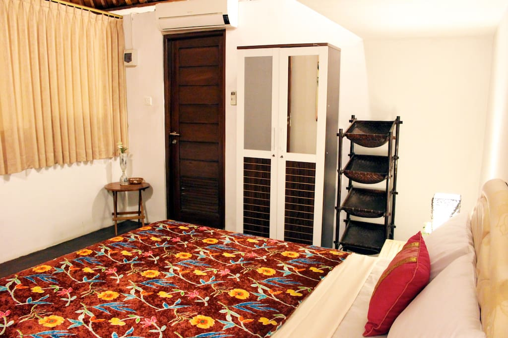 "Upstairs bedroom with ensuite bathroom, closet, queen size bed, 32"" Flatscreen TV with Satellite"