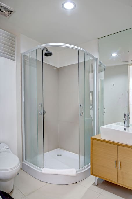 This is the second bathroom (with door), located behind the kitchen. You can use this bathroom if you have guests around.