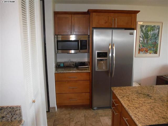 Totally renovated kitchen! All new stainless appliances & granite counters with plenty of prep space.