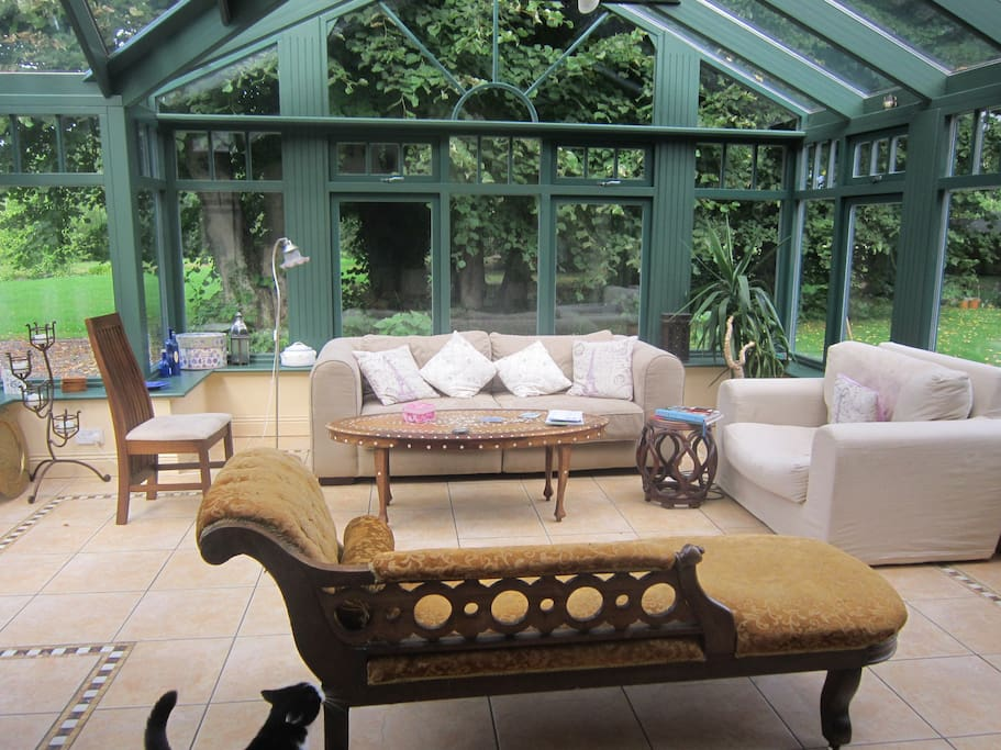 Big sunny conservatory  runs into the kitchen and dining area