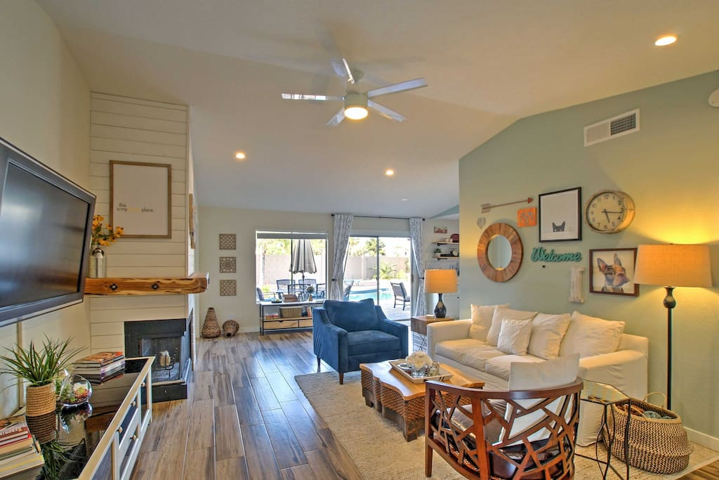 Inside, you'll find a spacious living room with beautiful hardwood-like tile floors.