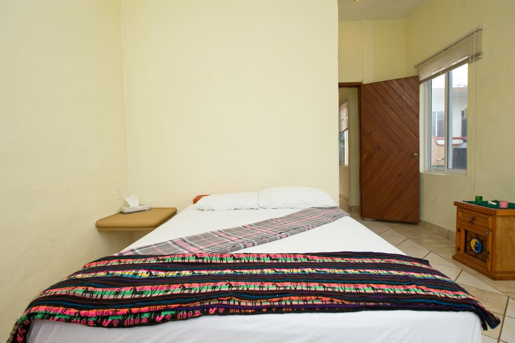 Private bedroom in the one bedroom unit.  All have air conditioning. Looking down to kitchen.