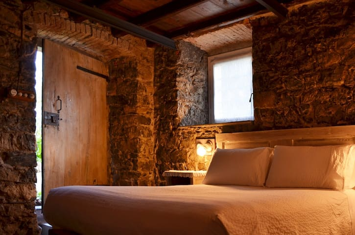 Room carved into the rock in the heart of Liguria