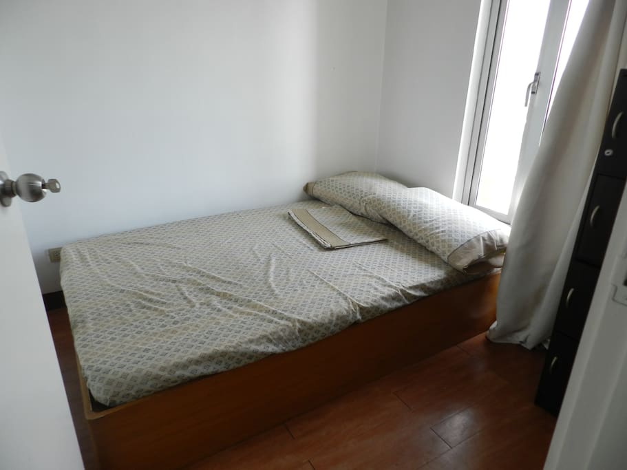 Bedroom 1.  It has a double bed and is air-conditioned.