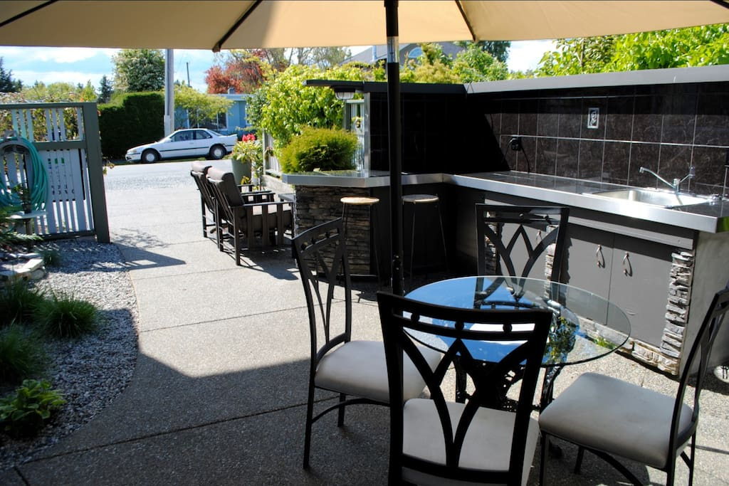 Guest patio with great BBQ.We often cook local seafood for our guests