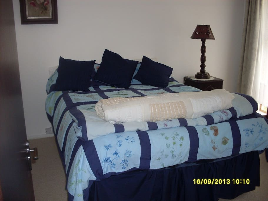 Comfortable Queen bed. Handcrafted duvet cover and cushions.