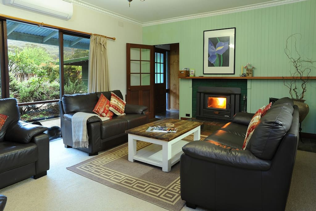 Spacious lounge with wood fire and reverse cycle air-con