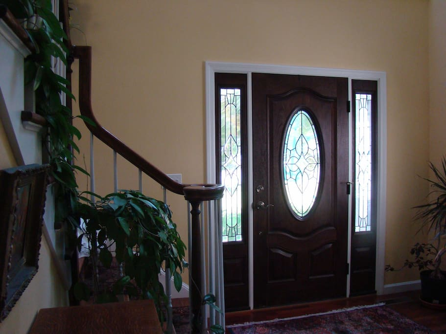 Through front entrance and up stairs to the suite
