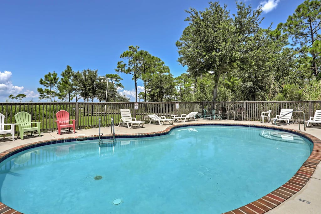 Spend your days soaking up the sun next to the community pool.