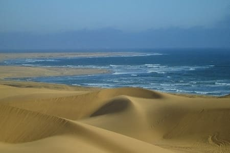 Exclusive Apartment on the first Floor to ensure maghificent views of the Namib Dunes and Atlantic Ocean. WiFi, TV, Dishwasher, Washing machine ext will make your stay a Holiday. You are walking distance from the CBD and Beach .