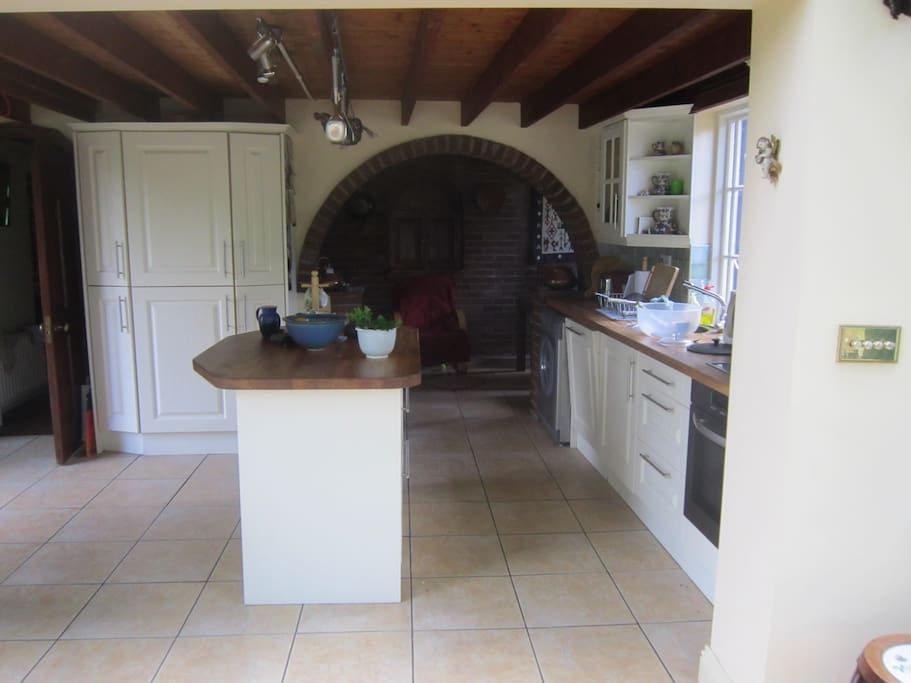 Kitchen with dining-area and oil-fired cooker through the arch.