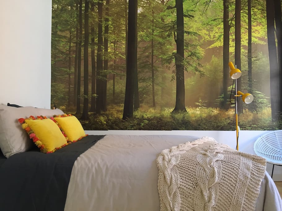 A space to relax and feel at home. Light filled bedroom with  Queen bed and crisp, quality linen bedding and sheets. The bedroom features a built-in wardrobe.
