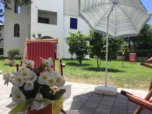 BEACH APARTMENT WITH GARDEN AND SWIMMING POOL