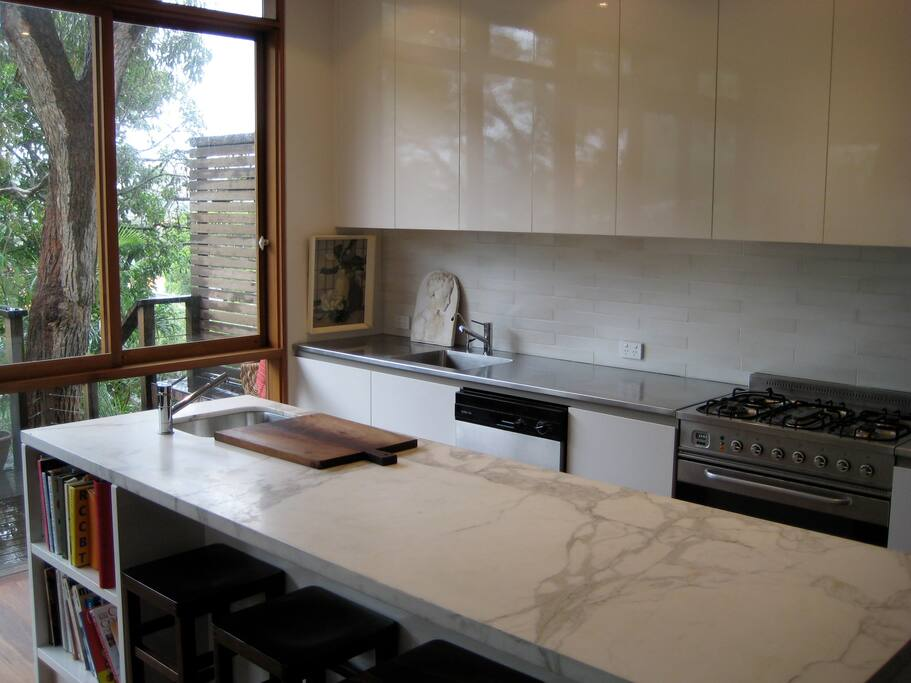 Kitchen with marble benchtop for casual meals in foreground