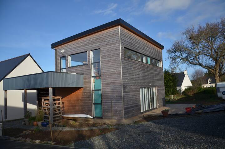Maison en bois vue sur mer