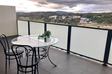 Top floor flat with great view & location!