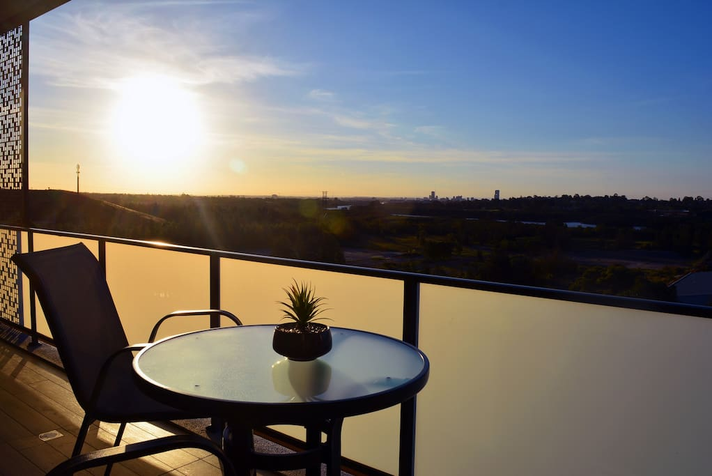 Our balcony features a bar table and chairs overlooking the horizon