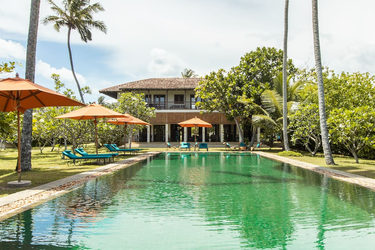 Unwind In Style at This Beautiful Beach Front Property