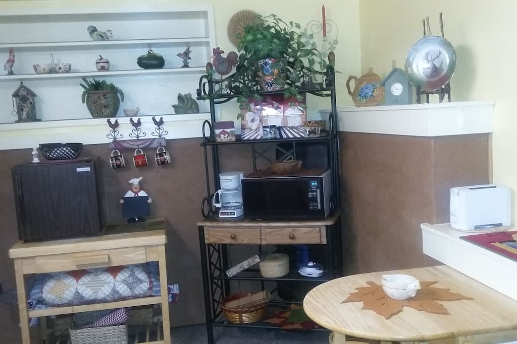 We furnish electric grill, microwave, toaster, blender, crock pot, electric skillet and coffee pot plus utencils, etc. We have an office size refreigerator and a place for your cooler ( to the left of it)  for beverages and ice.....