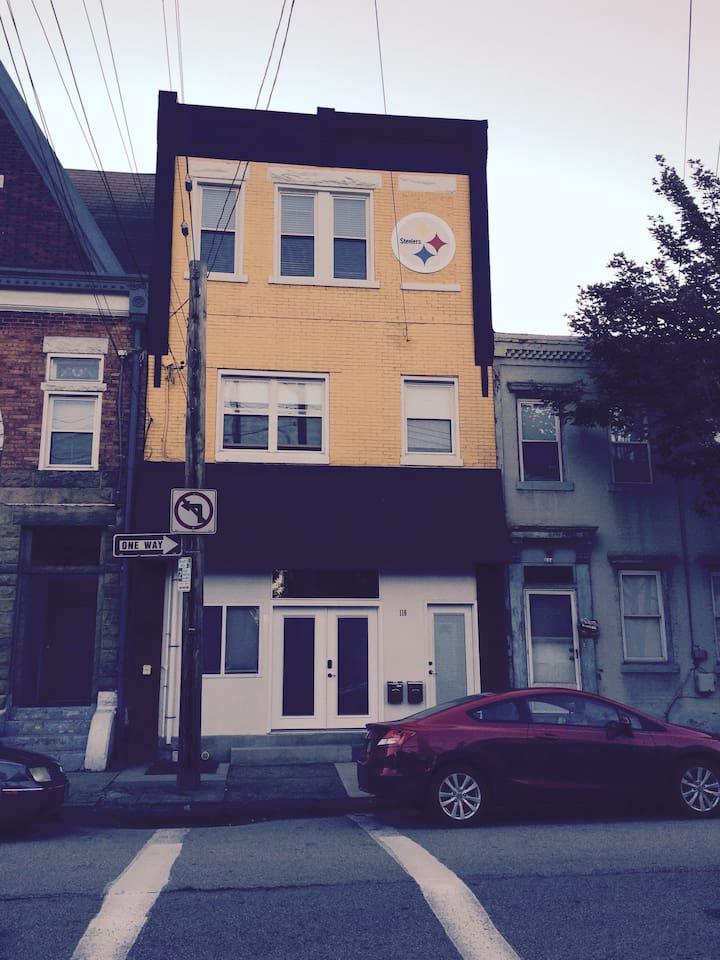 Street view of house, rental unit is bottom 2 floors