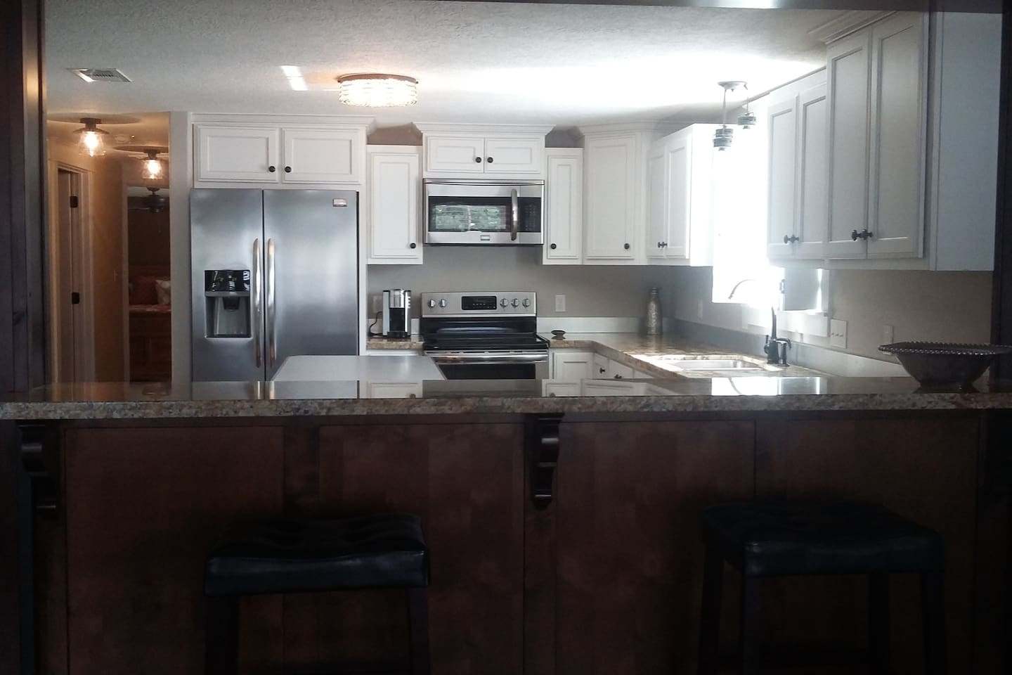 Full Kitchen with Stainless Appliances, Granite Countertops, Custom Cabinetry, Cookware, Dishes, and Keurig Coffee Maker.