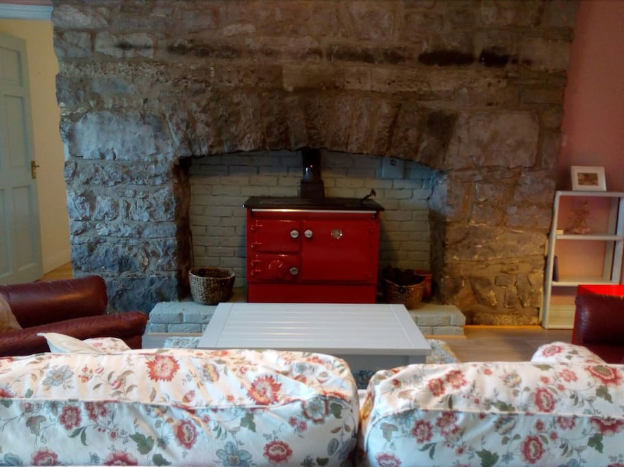 200 year old stone fireplace with traditional peat turf burning stove