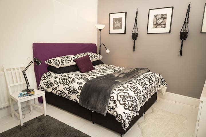 King size bed, luxury linens by Bohzaar and goose down duvet!