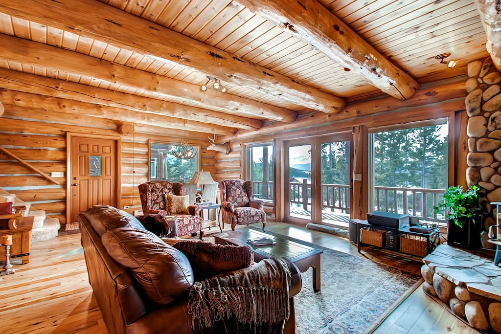 The 2nd floor living room features hardwood floors, hardwood ceilings, and log beams. Seriously, don't smoke inside...