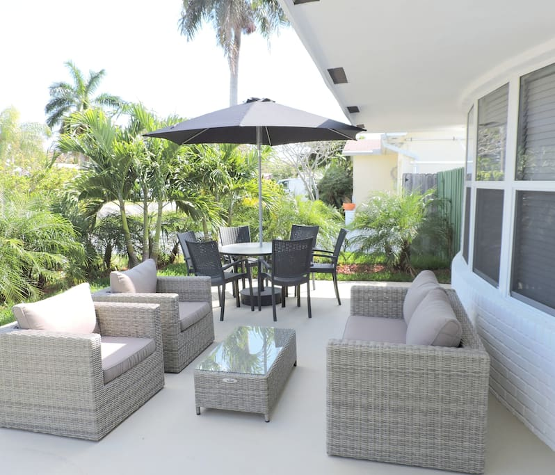 PRIVATE PATIO WITH DINING, LOUNGING AND  GAS GRILL