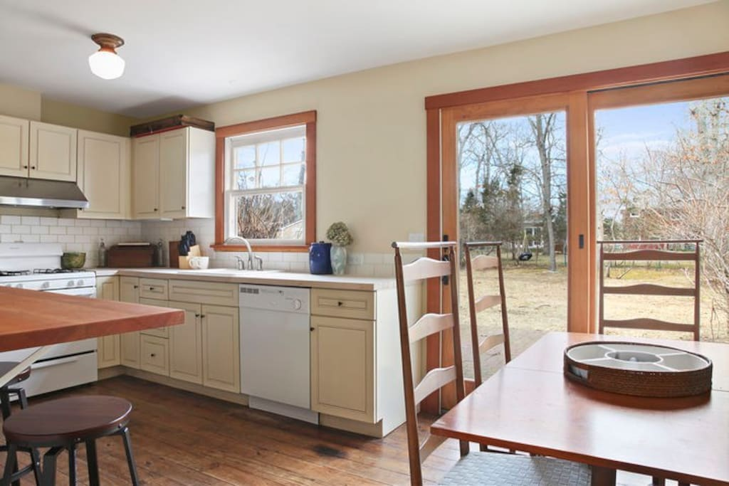 Eat in kitchen with breakfast bar, table for 6 and sliding door to back yard with outdoor teak dining for 8