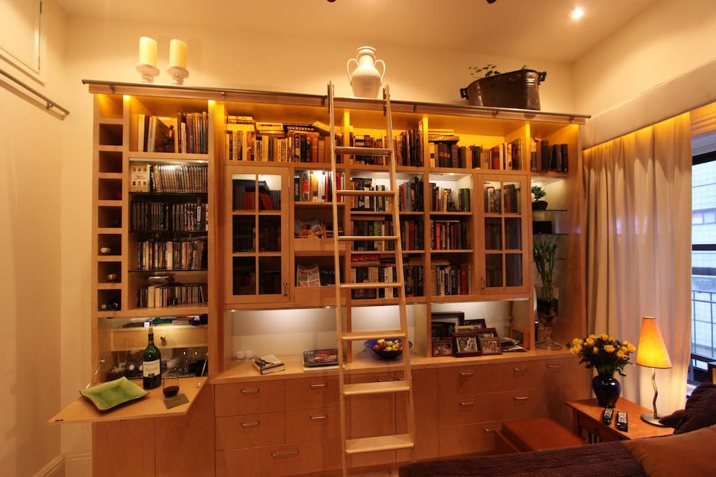 Front view of custom book case. Full library of books, periodical rack, drawers.k