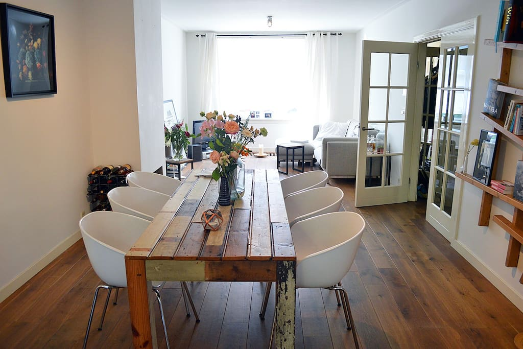 Enjoy a great dinner at this lovely dinner table and living area in the back