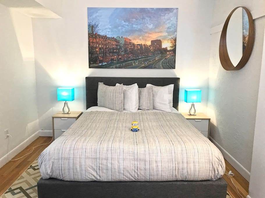 Rear Bedroom with Queen bed and our luxury mattress, high thread count sheets, and luxury pillows. Hey is that a Minion there too? ;)