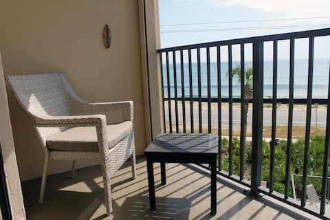 Sit on your oceanfront balcony overlooking the pool and enjoy the breezes and views.
