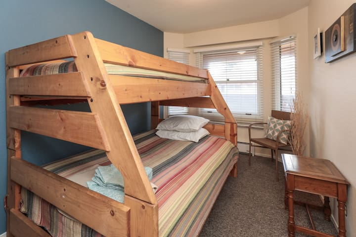 Guest bedroom with full size bed and upper twin bed.  Closet is to the left of this photo.
