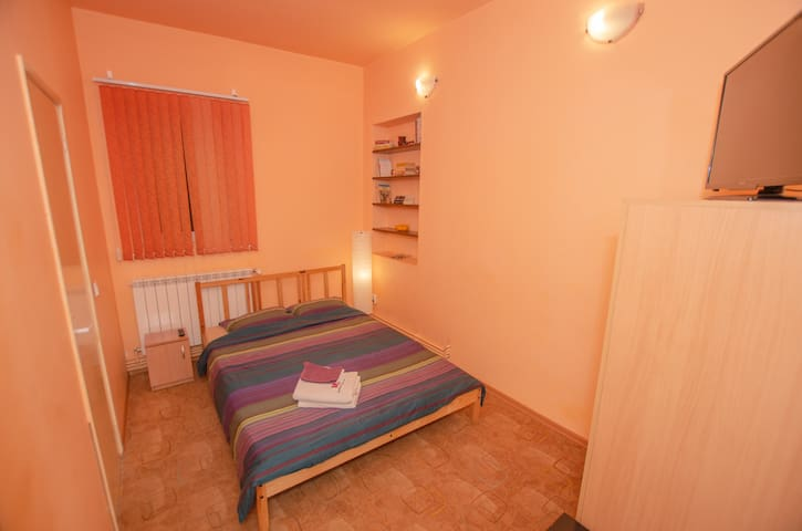 1'st room with double bed 140 cm, LCD TV with Netflix, Wi-Fi and private bathroom