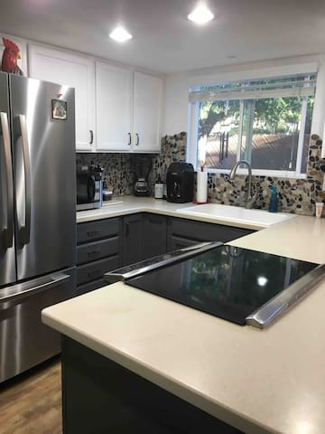 Lovely kitchen with all the amenities.   Great view of back yard