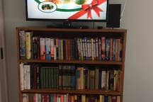 A good size TV in the bedroom and a mini library
