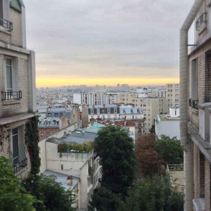 The view over Paris from the bedroom 2. Both bedrooms view on a green alley without cars : you'll sleep in perfect silence.