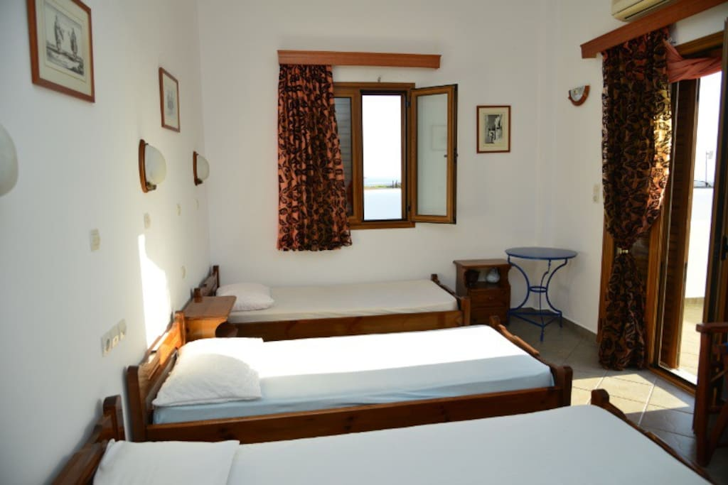 The open plan bedroom with 4 single beds