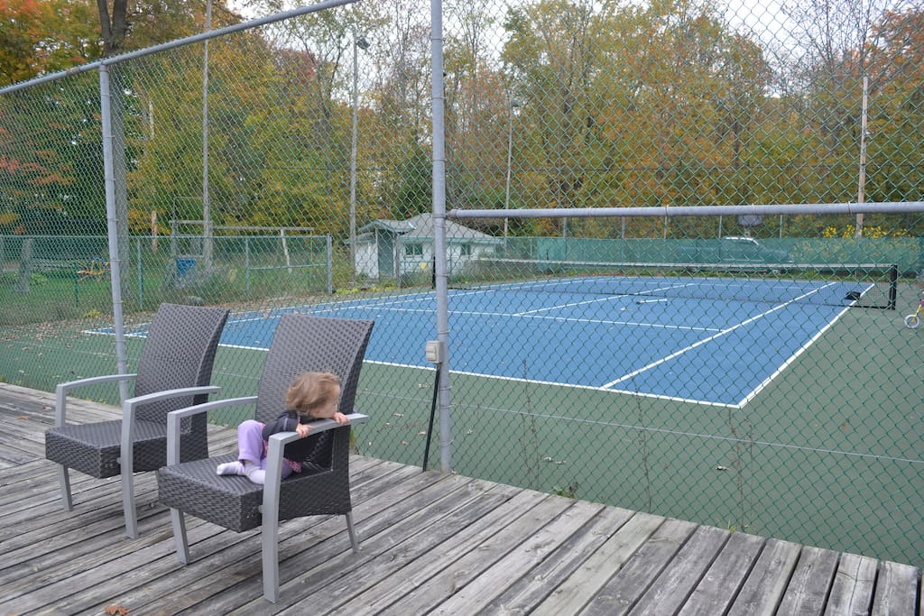 Full sized tennis court by the water
