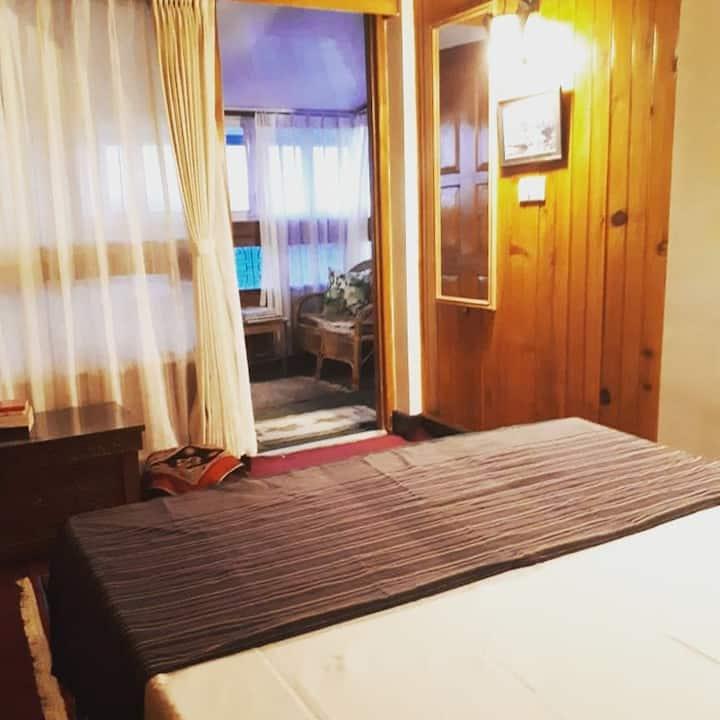 Villa Gombu wooden room with balcony