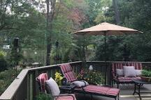 Shared Space-Large deck overlooking small lake.