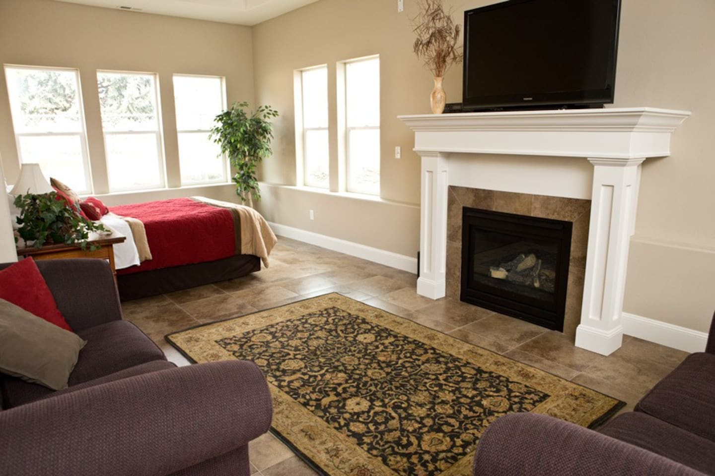 Bright and spacious main room with gas fireplace.