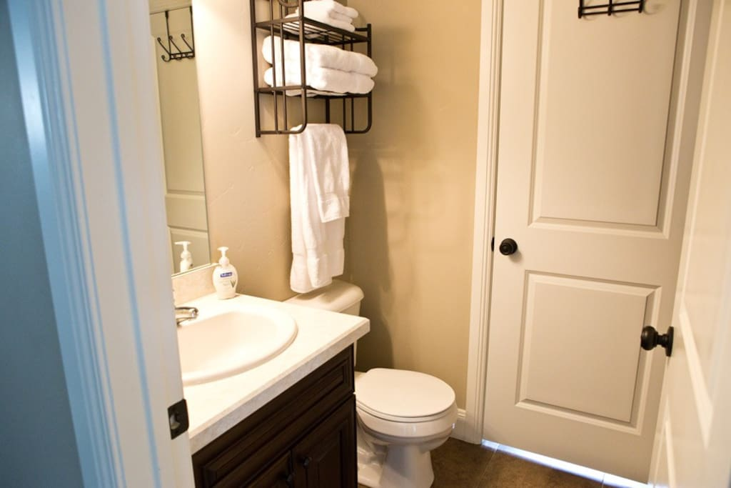 Clean, private, full bathroom.  Laundry is through the door at the rear of the bathroom.