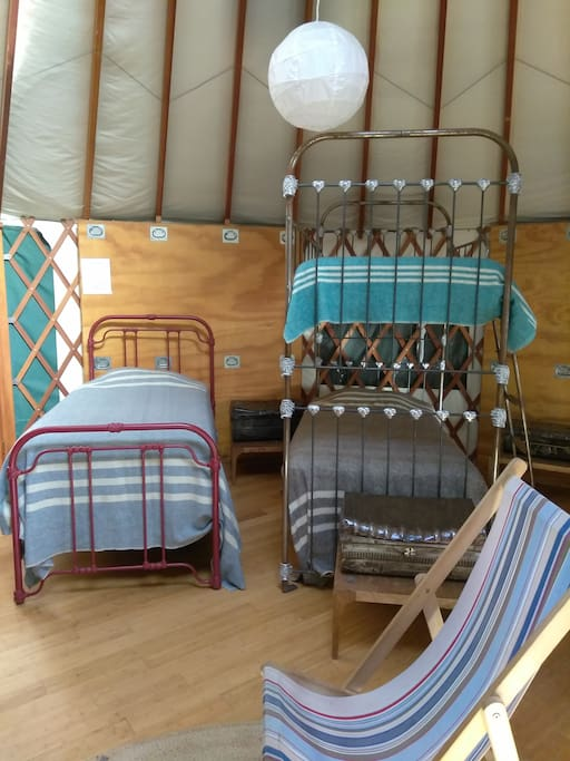Single and bunk beds allow up to 20 people to stay in the yurt at a time.  Bring friends, family, co-workers, plan an event, take a class or two, stay a night, stay a week!  Just as long as you have fun.