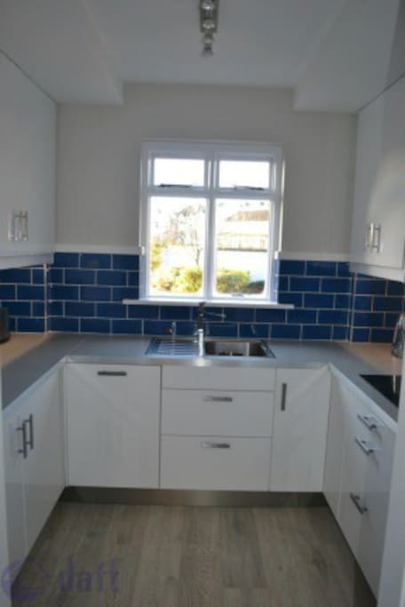 Fully integrated kitchen including dishwasher.