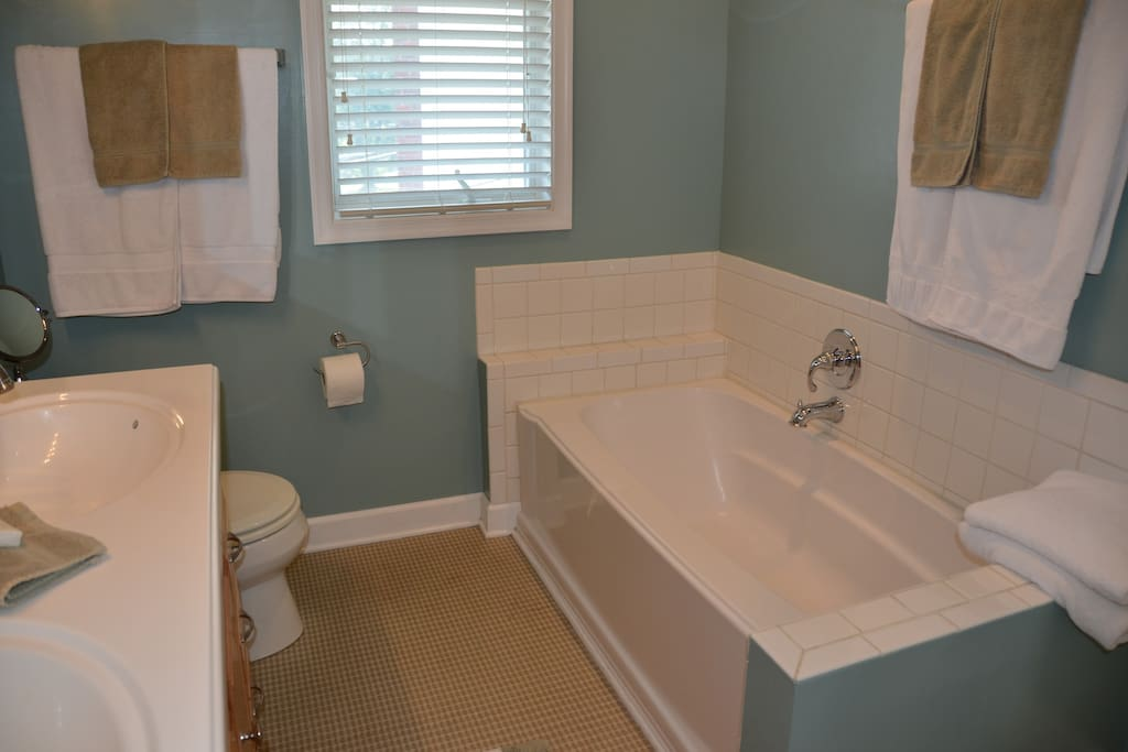 Double vanity, tub and separate shower bathroom