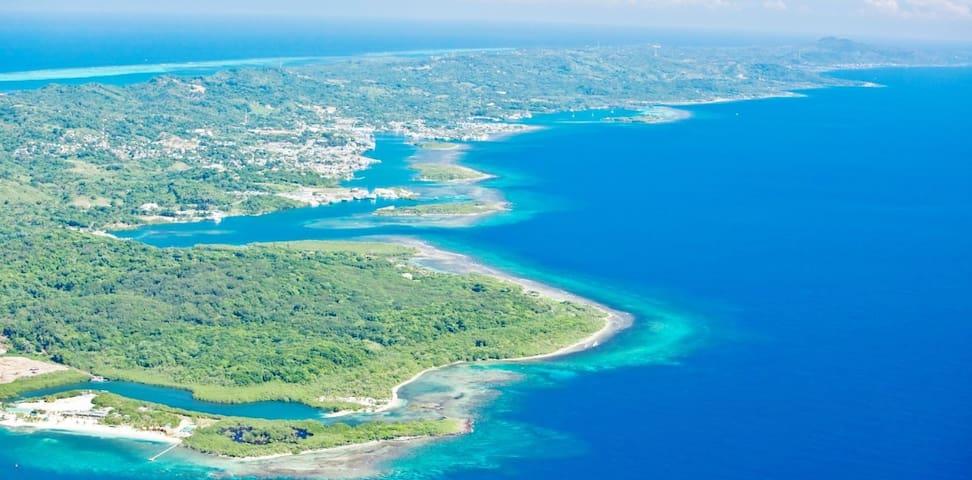 Aerial view of Caribbean sea around condo complex
